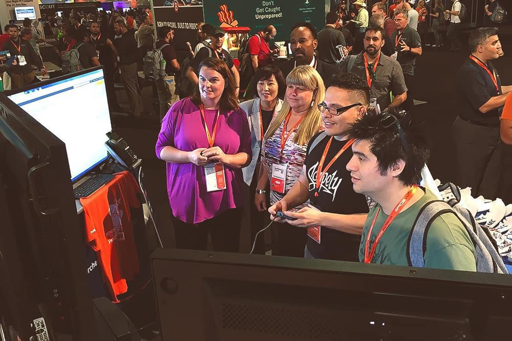 SpiceWorks Attendees Playing TurboGrafX-16 at NEC Booth